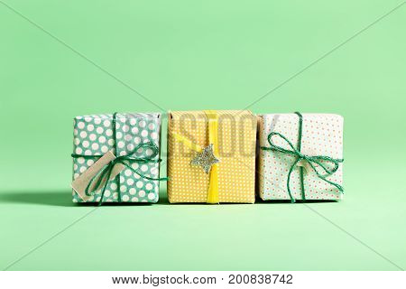 Little handmade present boxes on a bright background