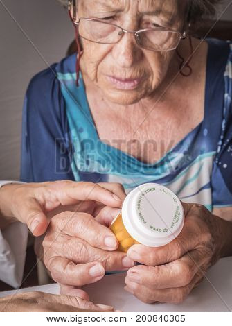Doctor explains to elderly daily dose of medication, Andalusia, Spain