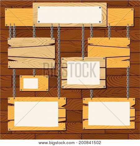 set of empty wooden sign boards hanging with chains on wooden wall background