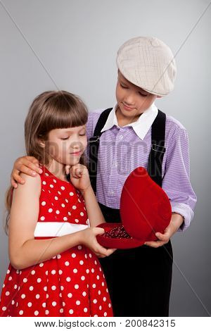 The Boy Gives Beads To The Girl. Retro Style.