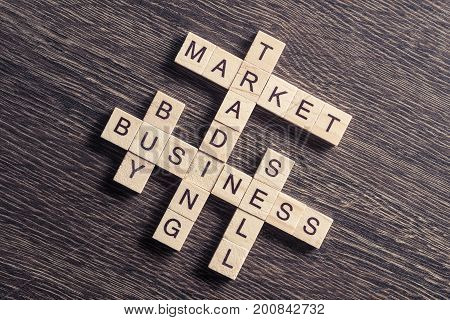 Words of business concepts collected in crossword with wooden cubes