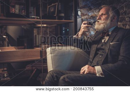 Senior man with a smoking pipe