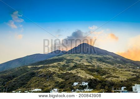 Last constructions from the beginning of the with vegetation to the top of the volcano stromboli surrounded by its fumaroles