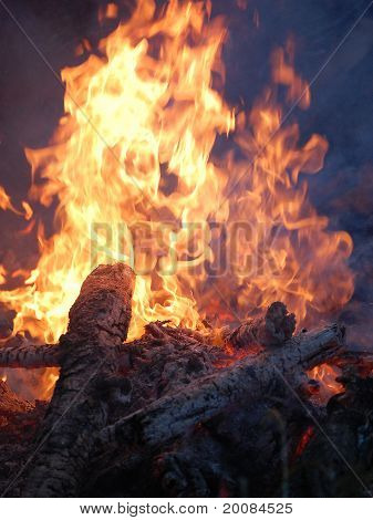 Creative fire with logs full view