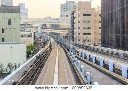 Tunnel railroad of elevated Yurikamome monorail train to Odaiba direction in Tokyo Japan.