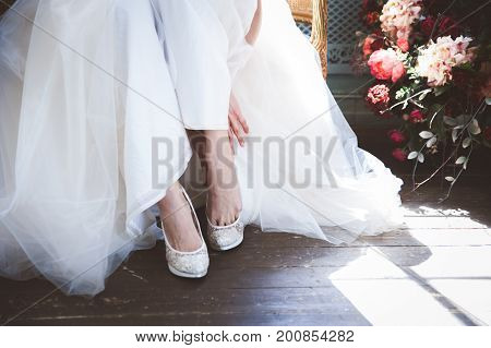 Bride is putting on her shoes, female, fashion