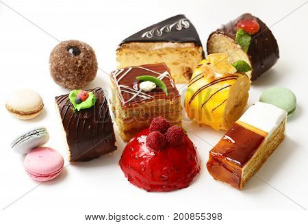 Assorted mini cakes sweet dessert, chocolate and fruit