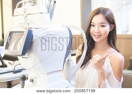 woman smile with optometry in the optical shop