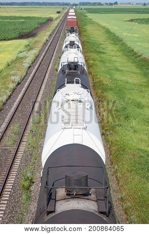 Overhead View of Railway Tank Cars in Prairie Rural Setting