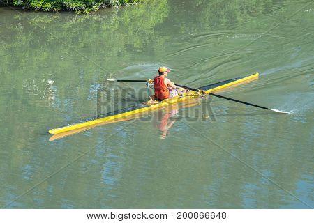 Teenage Sportsmen In A Boat, Rowing On The River Rioni, Poti, Georgia