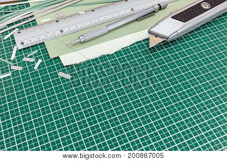 Cutting Equipment On Desk - Cutter, Metal Ruler With Pencil