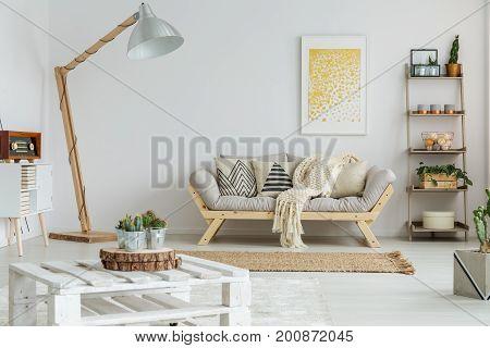 Yellow Painting Hangs Over Sofa