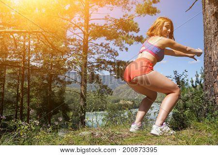 Woman Makes A Squat