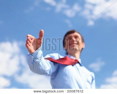 young businessman in a blue shirt and red tie