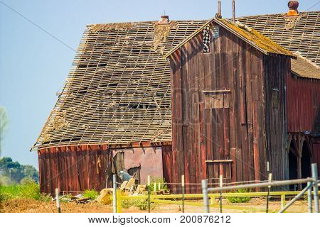 Old Abandoned Wood Barn With Roof Caving In