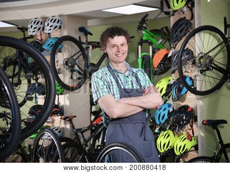 Young man standing in bicycle shop