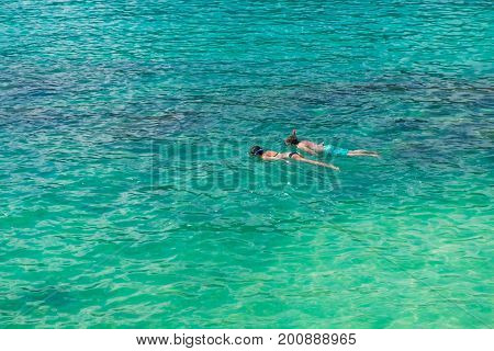 A man and a woman are snorkeling in the sea at Koh Lipe in Satun Thailand. Koh Lipe (Lipe island) is the first island the tourists select to travel on vacation.