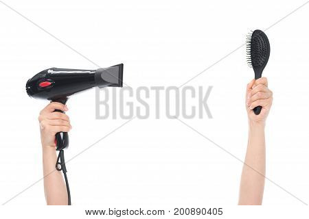 Hands Holding Hairbrush And Hairdryer
