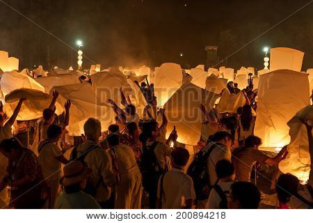 Chiang Mai, Thailand - October 25, 2014: People Preparing To Release Sky Lanterns To Pay Homage To T