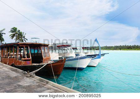 Boats berthed at tropical resort