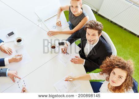 Finance department in meeting analizing statistics