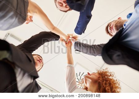 Successful team giving group High Five for team spirit lifting