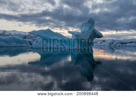 Melting Icebergs Reflecting In Jokulsarlon Glacier Lagoon. Base Of The Vatnajokull Glacier At Jokuls