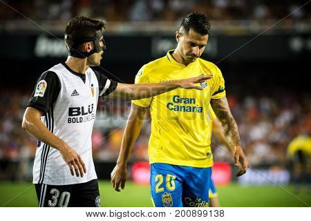 VALENCIA, SPAIN - AUGUST 18: Vidal (30) adn Vitolo (20) during Spanish La Liga match between Valencia CF and Las Palmas UD at Mestalla Stadium on August 18, 2017 in Valencia, Spain