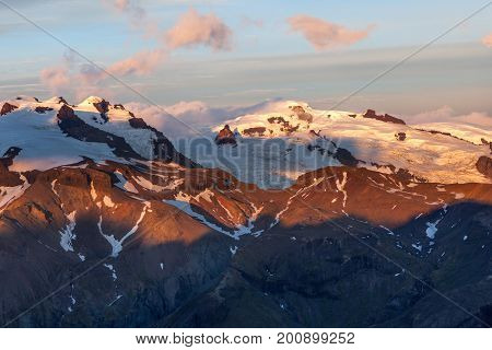 Volcano Mountain Covered With Snow On Sunset. Eyjafjallajokull Mountain In Southern Iceland. Breatht