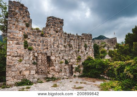 Ancient stone ruins and fortress wall in Old Bar town, Montenegro. Stari Bar - ruined medieval city on Adriatic coast, Unesco World Heritage Site.