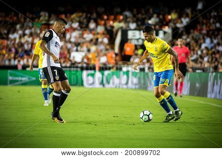 VALENCIA, SPAIN - AUGUST 18: Vitolo with ball during Spanish La Liga match between Valencia CF and Las Palmas UD at Mestalla Stadium on August 18, 2017 in Valencia, Spain
