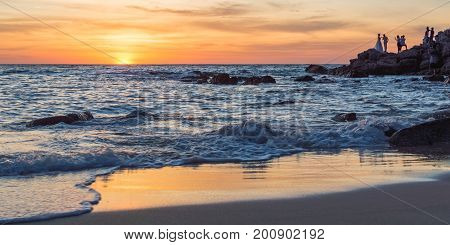 Sunrise Or Sunset Over The Sea View From Tropical Beach With Orange Sky