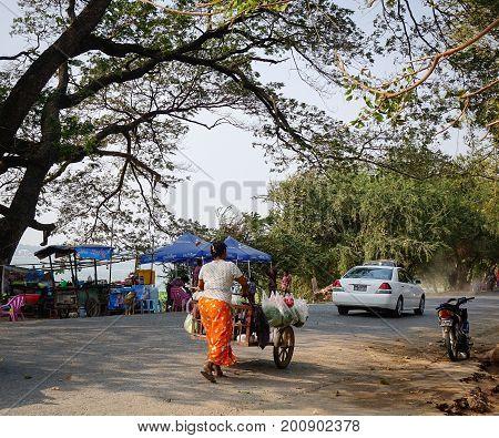 People Walking On Road In Mandalay, Myanmar