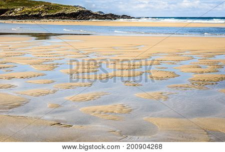Puddles Of Water On Sandy Beach After A Tide.