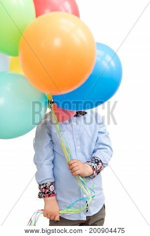 Boy hiding behind a bunch of balloons isolated on white background
