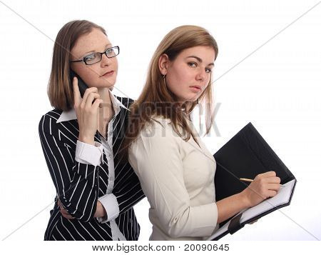 Two attractive young businesswomen