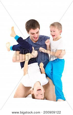 Two cheerful boys, playing with his father, isolated on white background