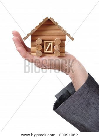 hand showing a wood chalet