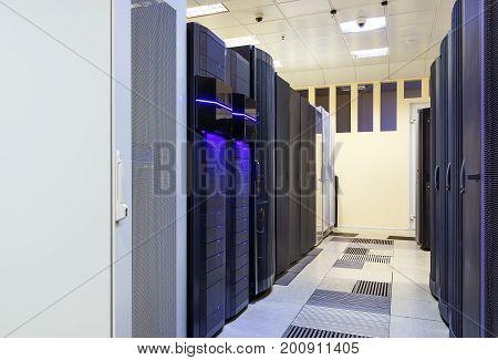 modern server room symmetry ranks supercomputers light