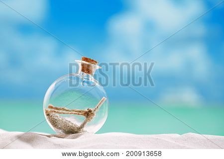 christmas tree bauble in  message bottle shape  on beach with seascape background