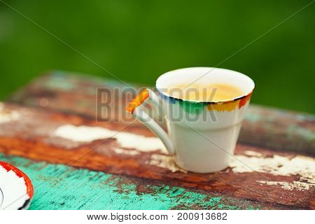 espresso coffee shot in vintage cup on art style table