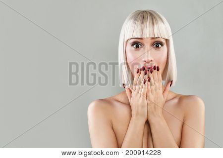 Happy Surprised Woman with Open Mouth. Blondie Model with Makeup and Bob Hairstyle on Banner Background