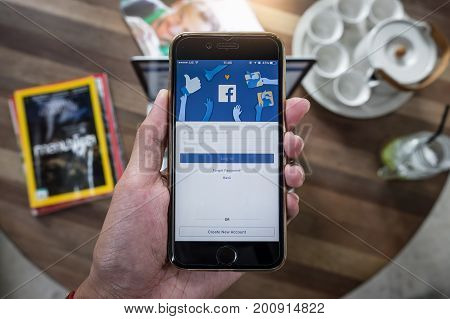 CHIANG MAI THAILAND - AUG 14 2017: A man holds Apple iPhone 6S with facebook application on the screen.facebook is a photo-sharing app for smartphones.