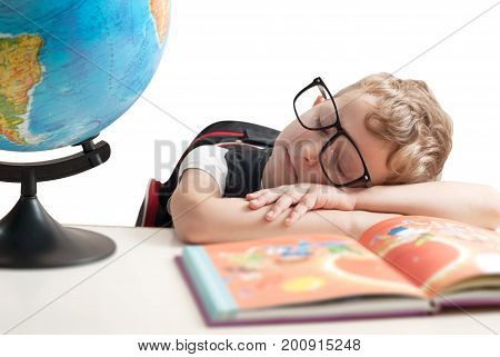 A Child Of Primary School Age Are Sleeping At The Desk