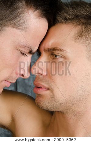 Quarrels and kisses. Love and relationships. Two sexy guys.