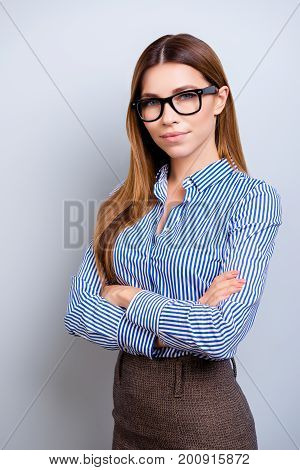 Young Successful And Confident  Business Lady Is Standing With Crossed Hands And Looks In Camera. Sh