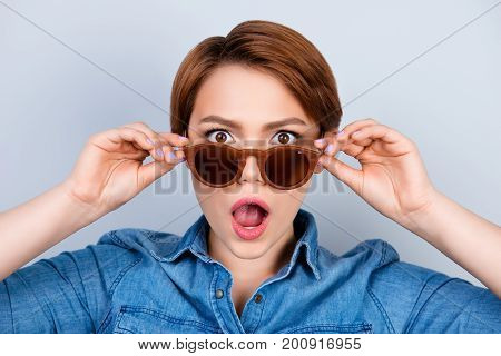 Close Up Portrait Of Shocked And Amazed Pretty Young Girl Touching Sunglasses
