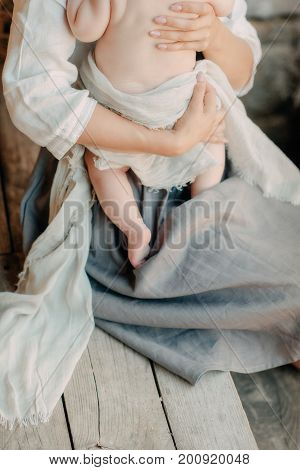 Newborn in the arms of the mother