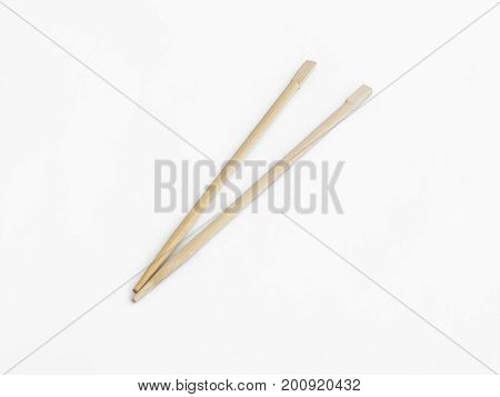 Traditional wooden sticks used for eating in East Asia isolated on a white background
