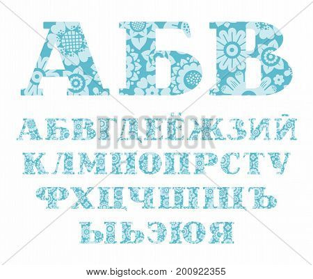 Russian alphabet, blue flowers, vector. Capital letters of the Russian alphabet with serif. Light blue, decorative flowers on a blue background.